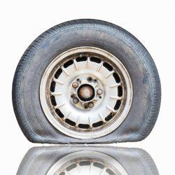 flat-car-tire-white-background