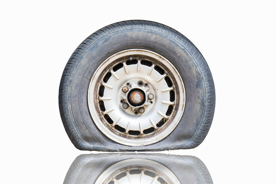 how far can you drive on a flat tire | flat-car-tire-white-background
